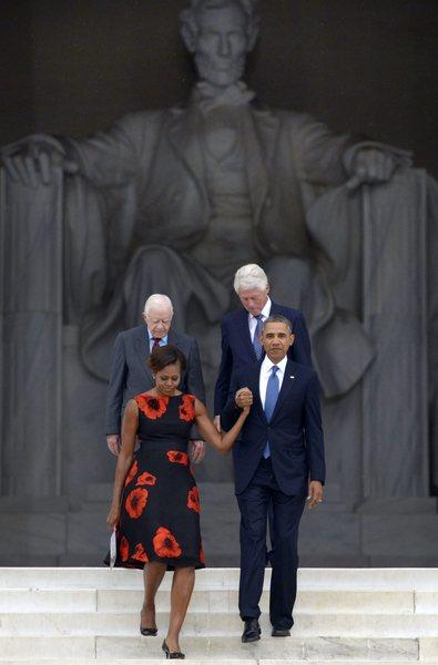 President Obama escorts First Lady Michelle Obama with former presidents Jimmy Carter and Bill Clinton during ceremonies at the Lincoln Memorial marking the 50th anniversary of the March on Washington.