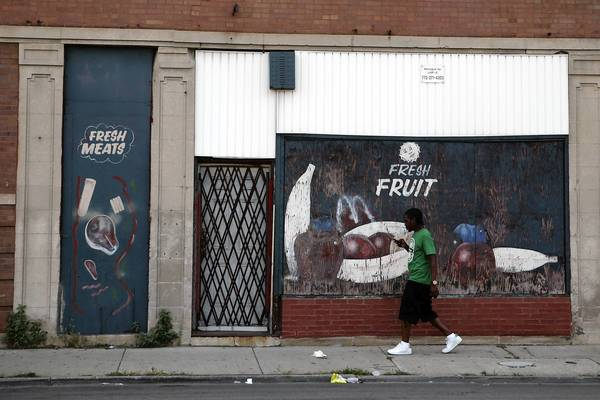 A small grocery stands boarded up last week on the 6800 block of South Racine Avenue.