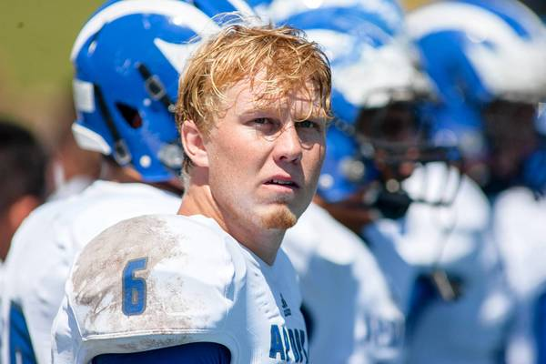 Apopka Blue Darters quarterback Zack Darlington watches a replay during the first half against the Byrnes Rebels at Nixon Field.