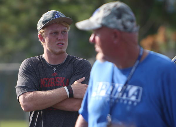 Out of the lineup after a concussion, Apopka quarterback Zack Darlington, with his father and head coach Rick Darlington in the foreground, was back on the field coaching up his teammates on Wednesday.