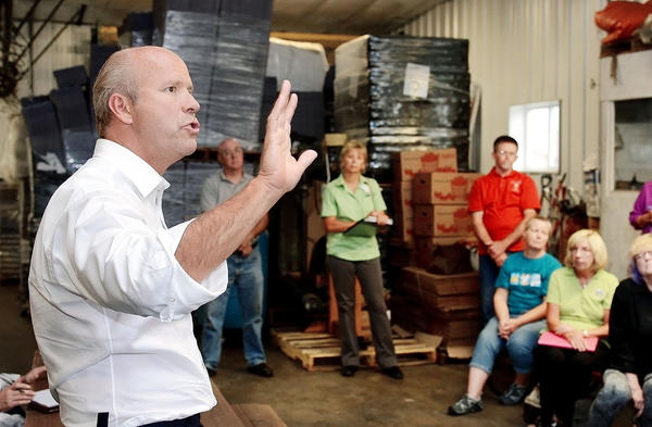 U.S. Rep. John Delaney talks during a gathering of area farmers and agriculture representatives Wednesday evening at Rinehart Orchards near Smithsburg.