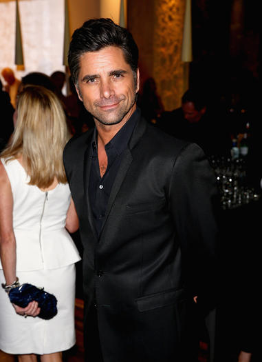 Actor John Stamos attends a summer celebration hosted by Delta Air Lines on August 15, 2013 in Beverly Hills, featuring celebrity guests, customers and L.A. influencers.