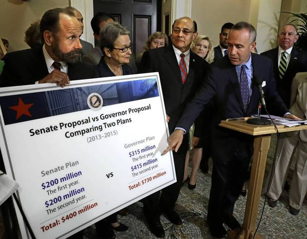 State Senate President Pro Tem Darrell Steinberg points to a chart that compares the cost of Senate Democrats' proposal to reduce prison crowding compared to the costs of the plan proposed by Gov. Jerry Brown. The presentation occurred at a news conference at the Capitol in Sacramento.