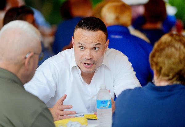 Dan Bongino, facing, spoke with local Republicans Wednesday night during the annual Washington County Republican Club's picnic at the North American Rod & Gun Club in Hagerstown.