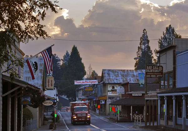 California Department of Forestry crew trucks move through Groveland on Wednesday.