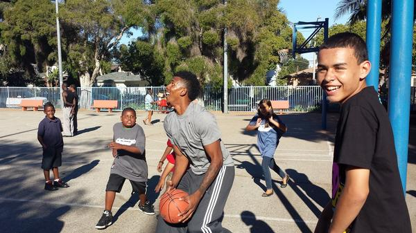 Nick Young shoots around with children at a back-to-school event he hosted at Robertson Park.