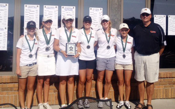 The Harbor Springs girls golf team won the Traverse City West Invitational Wednesday as they finished with a team score of 375. Team members are (from left) Zoey Bezilla, Abby Detmar, Ellen Breighner, Sadie Cwikiel, Perry Bower, Leah Collie and assistant coach Joe Breighner.