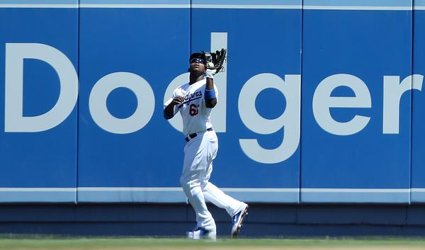 Los Angeles Dodgers right fielder Yasiel Puig catches a fly at the wall off the bat of the Chicago Cubs' Brian Bogusevic in the fourth inning at Dodger Stadium in Los Angeles, on Wednesday, August 28, 2013. The Dodgers won, 4-0.
