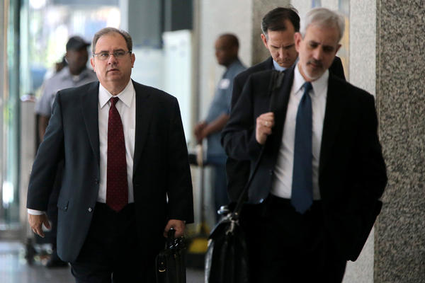 Sacred Heart Hospital CEO Edward Novak, left, charged in major medicare fraud scheme, leaves the Dirksen U.S. Courthouse with his attorneys on Thursday.