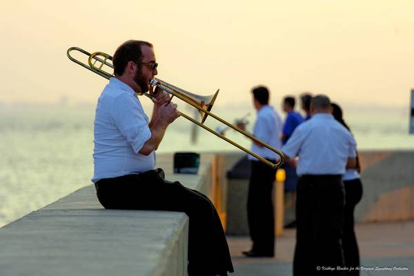 The Virginia Symphony is scheduled to play a free concert at Fort Monroe. In this photo, trombonist John Sipher warms up before a 2012 concert at Fort Monroe.