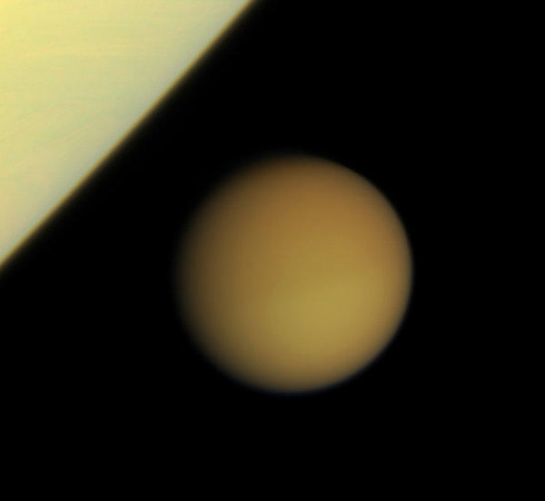 NASA's Cassini spacecraft captured this photo of Titan, Saturn's largest moon, on Jan, 29, 2008. New research finds that Titan's icy shell is thicker and more rigid than previously thought.