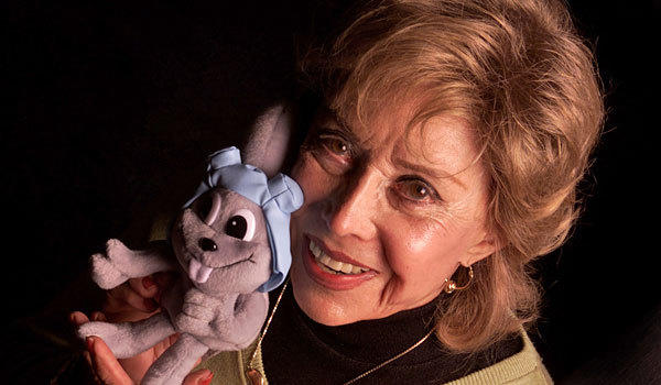 June Foray poses with Rocky the Flying Squirrel.