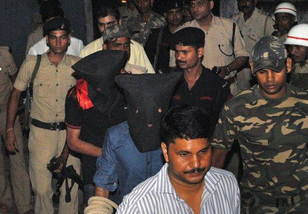Two suspects in black hoods, including Yasin Bhatkal, an alleged founder of the militant group Indian Mujahedin, are taken to a court Thursday by police in Motihari, India.