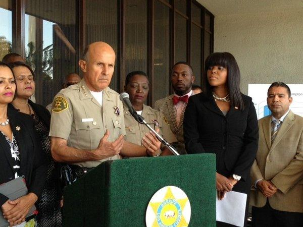 At a news conference at Compton City Hall, Los Angeles County Sheriff Lee Baca addresses a recent increase in crime in the city. He is accompanied by Mayor Aja Brown, right.