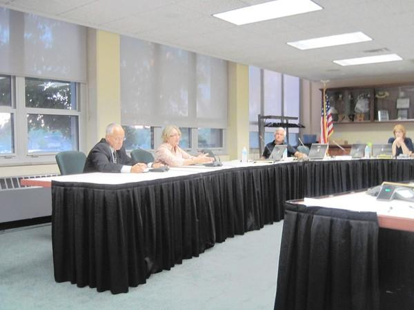 From left, Steve Humphrey and Patsy Svare, discuss filling positions at Hindale Township High School District 86 with temporary hires.