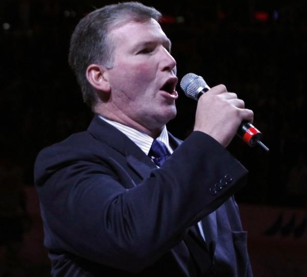 Jim Cornelison sings the National Anthem before the start of a Blackhawks hockey game at the United Center in Chicago on Friday, October 30, 2009. Cornelison will perform at the Chicago Speedway on Saturday, September 14 at the start of the Dollar General 300 powered by Coca-Cola.