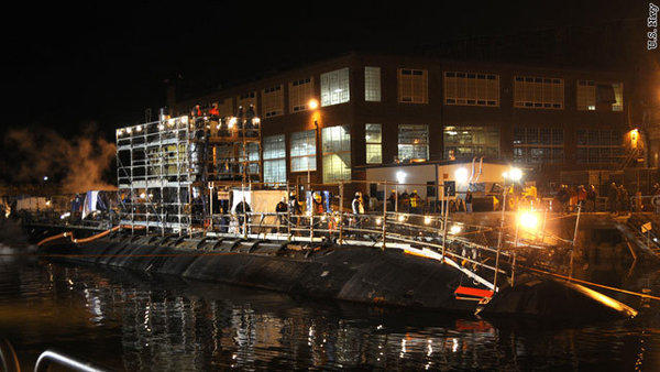 The Los Angeles class attack submarine USS Miami enters drydock to begin an overhaul at Portsmouth Naval Shipyard.