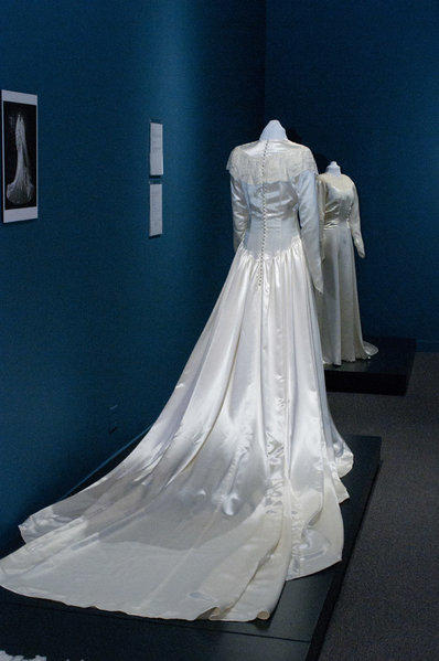 A wedding gown worn by Julia Joyce Cahill, foreground, and a dress worn by six brides at Manzanar are among the bridal attire on display at the Pasadena Museum of History.