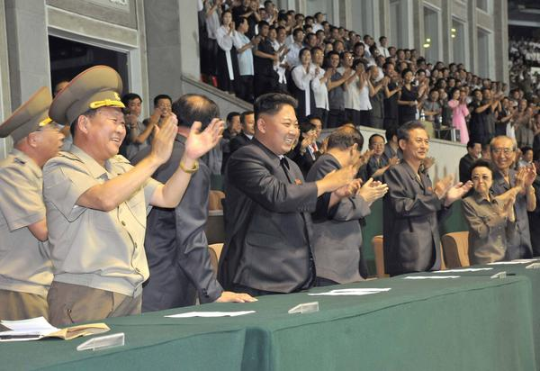 North Korean leader Kim Jong Un, center, at a soccer game in Pyongyang on Wednesday. A South Korean newspaper reported Thursday that the North Korean dictatorship had executed a former girlfriend of Kim and 11 other performers on Aug. 20 for alleged violation of pornography laws.