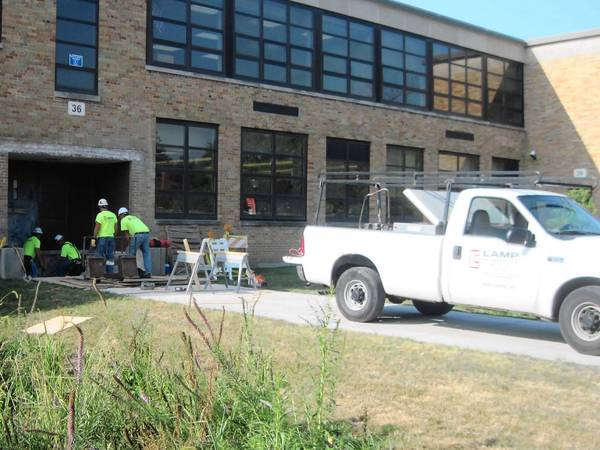 Workers are expected to complete about $1.2 million in work at Hinsdale Central and Hinsdale South High Schools by the end of the year.
