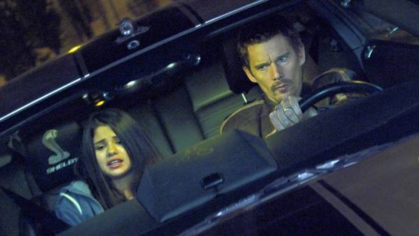 "Selena Gomez as the Kid and Ethan Hawke as Brent Magna in ""Getaway."""