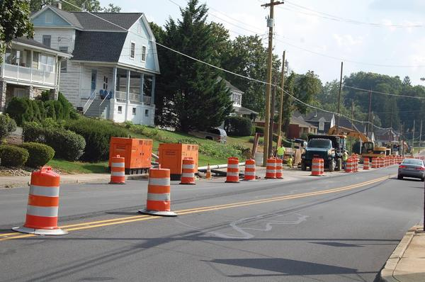 Crews continue their stormwater work Thursday afternoon on South Potomac Street in Waynesboro, Pa. The work has affected traffic patterns on the busy thoroughfare.