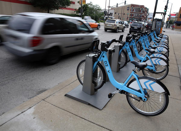 A Divvy bike share station on Chicago Avenue at Ogden Avenue in Chicago is seen on July 9, 2013.
