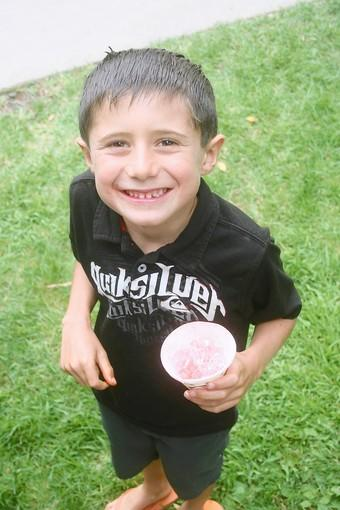 Parker Brown enjoys a snow cone.