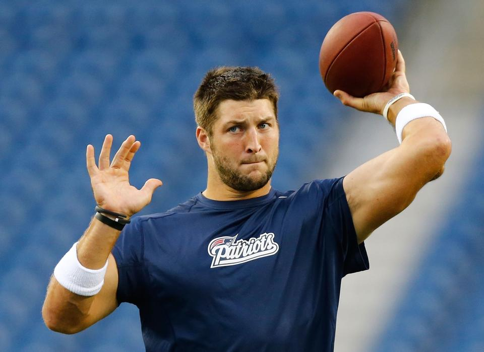 Tim Tebow #5 of the New England Patriots warms up prior to the preseason game against the New York Giants at Gillette Stadium