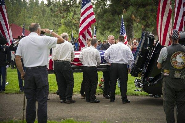 Pallbearers remove Delbert Belton's casket from a hearse during a graveside service in Spokane, Wash. The World War II veteran, beaten to death during a robbery, was buried with full military honors.