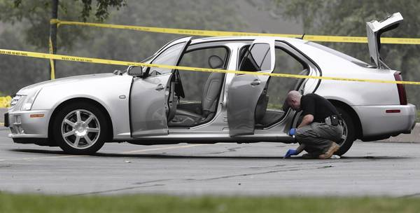 Police investigate the shooting in the parking lot of St. Mark Coptic Orthodox Church of Chicago in Burr Ridge.