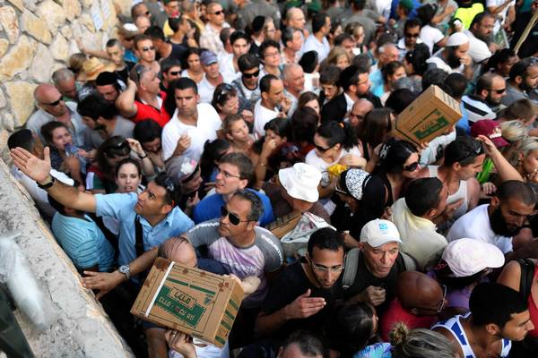 Hundreds of Israelis wait in line to collect gas mask kits in the city of Haifa on Aug. 29. Authorities responsible for distributing the gas masks say demand has grown in the last few days because of developments in Syria.