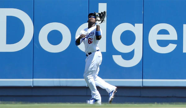 Dodgers outfielder Yasiel Puig catches a fly ball during the fourth inning of the Dodgers' victory over the Chicago Cubs, 4-0, on Wednesday.