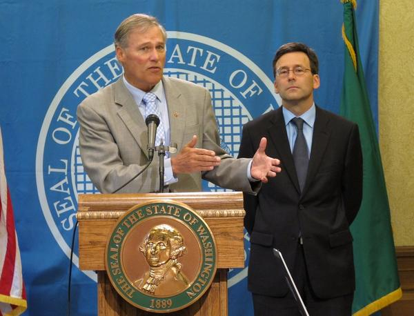 Washington Gov. Jay Inslee, left, is joined by state Atty. Gen. Bob Ferguson at a news conference to discuss the federal government's decision not to interfere with marijuana laws in Washington and Colorado.