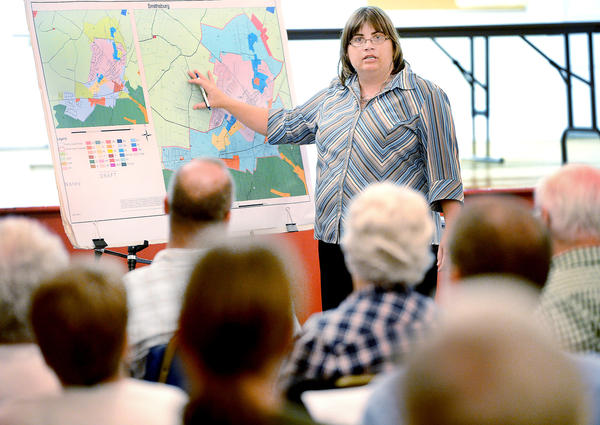 Jill Baker, a Planner with Washington County, answers questions about proposed Smithsburg area growth from the people gathered Thursday night at Smithsburg Town Hall.