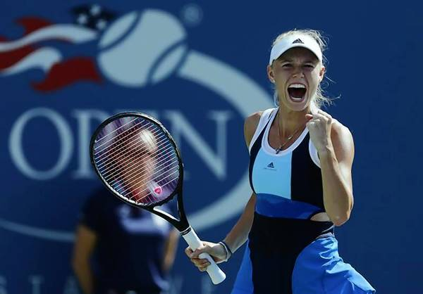 Caroline Wozniacki of Denmark celebrates after winning match point against Duan Ying-Ying of China at the U.S. Open tennis championships in New York August 27, 2013.