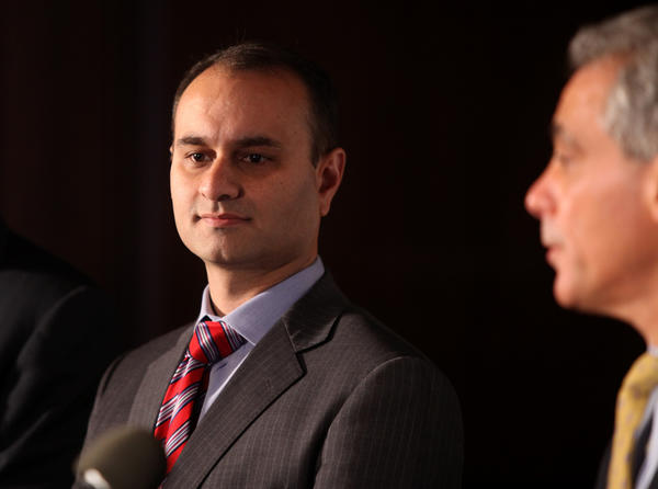 Amer Ahmad, left, with Rahm Emanuel during a press conference in Chicago, April 20, 2011.
