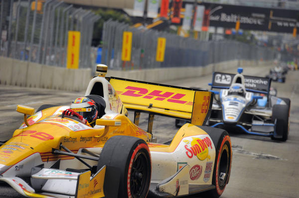 Race car driver Ryan Hunter-Reay leads the pack, including Ryan Briscoe (2) in the final lap of the Grand Prix of Baltimore in Baltimore, Maryland on Sunday, September 2, 2012.