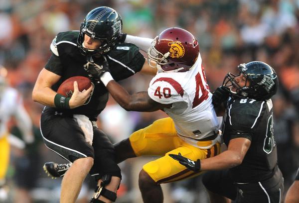 USC linebacker Jabari Ruffin tries to sack Hawaii quarterback Taylor Graham at Aloha Stadium.