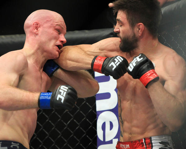 Carlos Condit (red gloves) fights Martin Kampmann (blue gloves) during UFC Fight Night 27 at Bankers Life Fieldhouse.