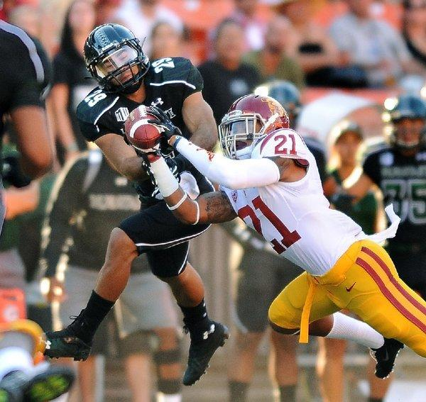 USC's Su'a Cravens intercepts a pass in front of Hawaii receiver Scott Harding in the first quarter.