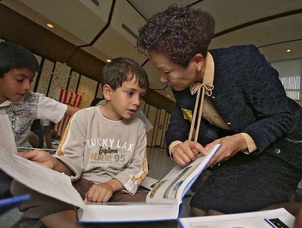 Edrin Boghomian and Rotary Club past president Makiko Nakasone look over brand-new dictionary given to 2nd graders at Cerritos Elementary in 2009. (File Photo/News-Press)