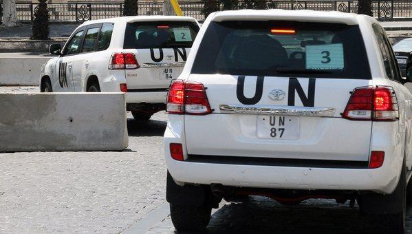 A convoy of United Nations chemical weapons inspectors leaves a hotel in the Syrian capital, Damascus.