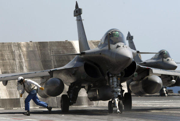 A French Rafale fighter jet, of the type available to fly sorties in support of U.S.-led strikes against Syria, sits aboard the aircraft carrier Charles de Gaulle.