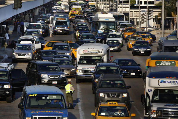 A traffic jam caused by travelers leaving early Friday morning on Labor Day weekend at Los Angeles International Airport.