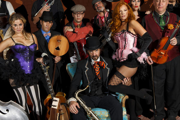 Andy Comeau (a.k.a. Vaud Overstreet), seated center, and his band Vaud & the Villains have been playing an increasing number of performances outside the Southland. Friday night, though, they'll be at the Ford Amphitheatre in Hollywood.