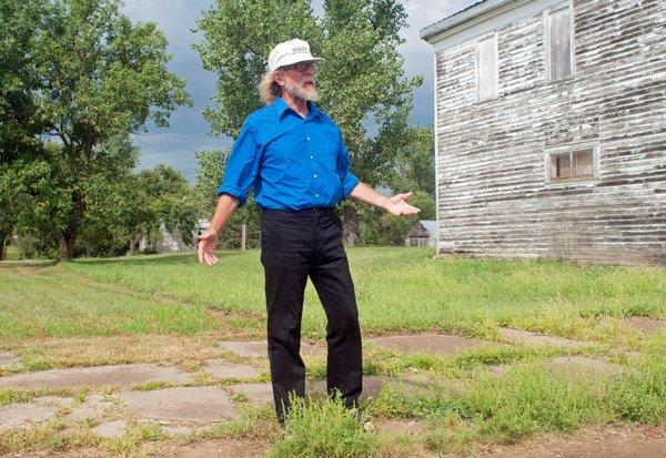 "Craig Cobb stands in an empty lot he owns on Main Street in Leith, N.D. Cobb wrote on a white supremacist message board that ""we could declare a Mexican illegal invaders and Israeli Mossad/IDF spies no-go zone."""