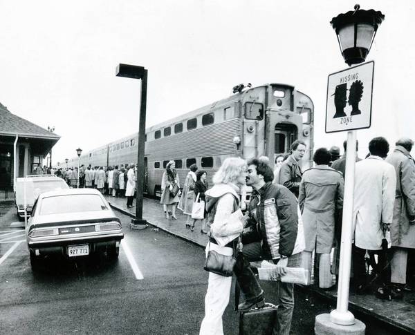 A couple kisses goodbye as a Milwaukee Road commuter train pulls into Deerfield Station on Nov. 21, 1979.