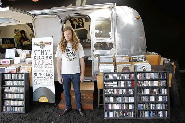 Parker Macy stands outside Creme Tangerine, which is housed in an Airstream camper at the LAB in Costa Mesa.