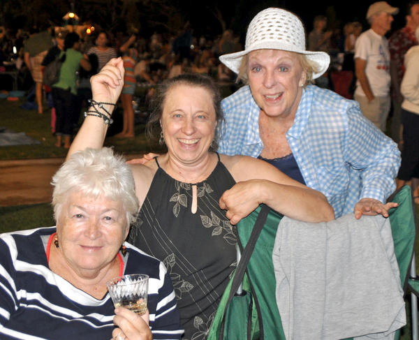 Brenda Mikhail, from left, Lucy Waldschmidt and Star deRose, enjoy Dean Colley and his Hot August Night Neil Diamond Tribute Band at La Cañada Flintridge Memorial Park Sunday, Aug. 25, 2013.